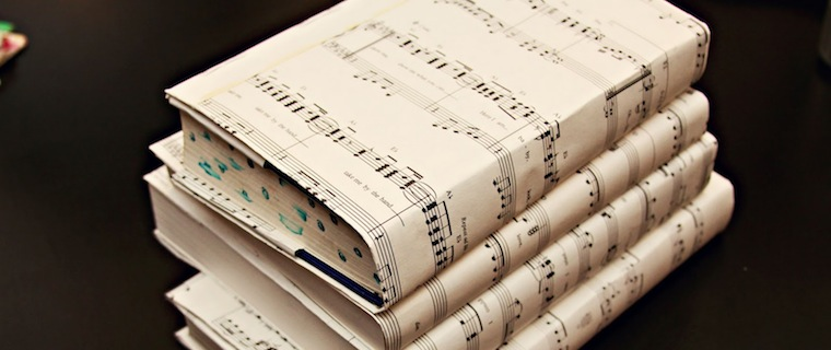 Books wrapped in sheet music